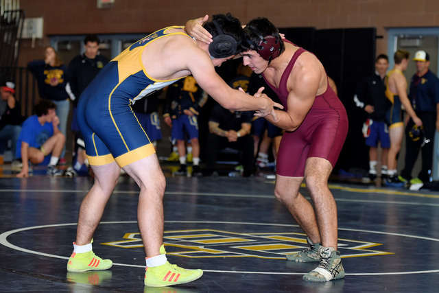 Peter Davis / Special to the Pahrump Valley Times  Garrett Monje (182 pounds)  takes on a Boulder City opponent. He won that match and was undefeated that day at 5-0.