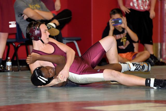 Peter Davis / Special to the Pahrump Valley Times  Chase Pattrella goes for the pin and displays his moves at Western.