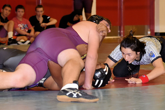 Peter Davis / Special to the Pahrump Valley Times  Cole Walker takes down his opponent at Western.