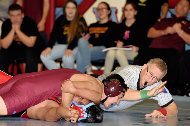 Junior Ulisses Perez (138 pounds) takes his Western opponent to the ground in last week's victory over Western and Sunrise Mountain. At the end of the day, the Trojans had their first two confer ...