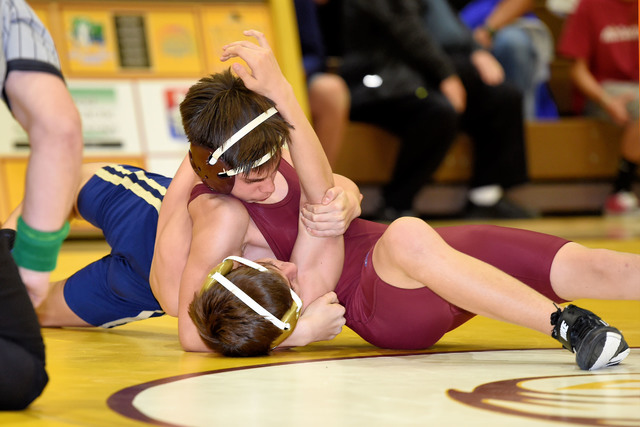 Freshman Wyatt Platt (113 pounds) gets a pin against Cheyenne on Wednesday night.  Peter Davis / Special to the Pahrump Valley Times