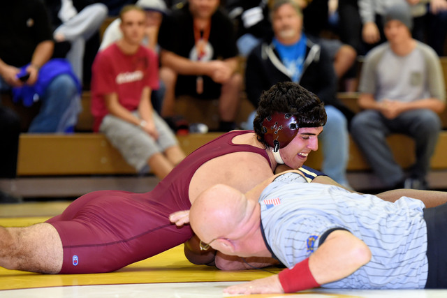 Senior Garrett Monje (170 pounds) pins his opponent from Cheyenne on Wednesday night. Monje helped the Trojans to a 51-27 win over their league rivals.  Peter Davis / Special to the Pahrump Valley ...