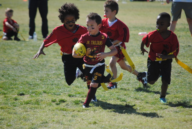 Aeden Reddit had a successful game running for the Junior Trojans, 5 and 6 year olds.  Charlotte Uyeno / Special to the Pahrump Valley Times