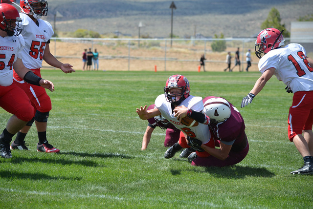 Jo Eason Special to the Times-Bonanza & Goldfield News  Senior quarterback Tanner Otteson rushes for some yards against Sierra Lutheran on Friday. Otteson had 112-yards rushing and 3 rushing t ...