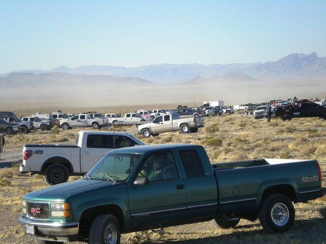 Support vehicles and fans gather at the first pit stop for the Pahrump 250 on Dec. 3 nearly 15 miles outside of Pahrump. The event attracted close to 150 racers this year, selling out hotel rooms  ...