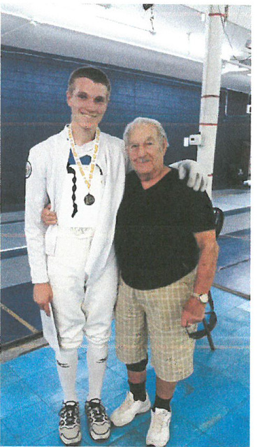 Pahrump Valley High senior fencer Dylan Metscher, left, stands with his esteemed coach, Master Mel North.  Special to the Pahrump Valley Times