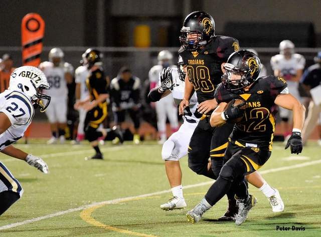Peter Davis Special to the Pahrump Valley Times Tommy Gascoigne runs with the ball in his last season as a Trojan. Gascoigne was accepted by West Point in February and was the first student from P ...