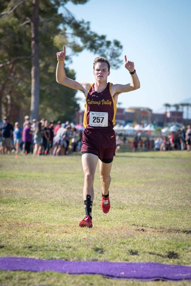 Bryce Odegard crosses the finish line in November, winning the first Trojans individual state title for boys cross-country. Special to the Pahrump Valley Times
