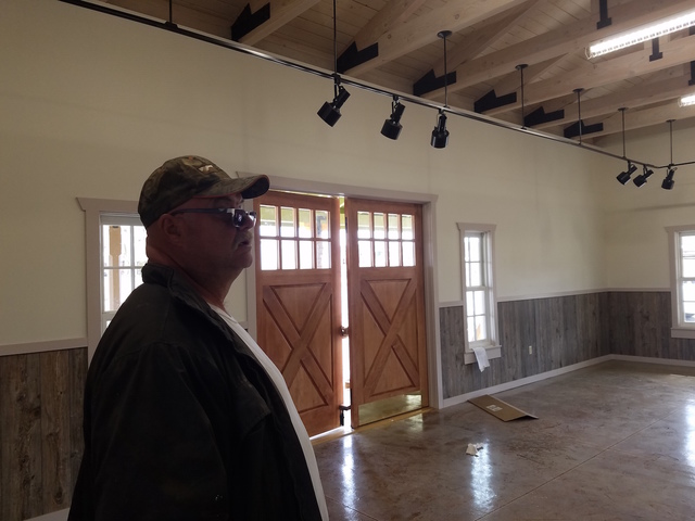 Esmeralda County official Mike Anderson discusses the newly built visitors center in Goldfield as shown in this Oct. 26 photo. The building is complete, but other efforts continue in anticipation  ...