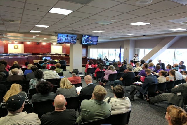 Business owners and low-wage workers watch on screens Wednesday at the Grant Sawyer Building in Las Vegas as the Nevada Legislature discusses AB175. The measure would raise the minimum wage by $1. ...