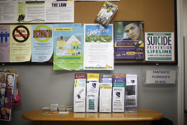 A wall of suicide prevention flyers is seen on Wednesday, Nov. 30 at the Department of Health and Human Services office in Las Vegas. Rachel Aston/Special to the Pahrump Valley Times