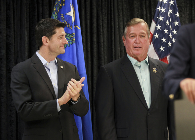 Speaker of the House Paul Ryan, R-Wis., left, attends a rally in support of U.S. Rep. Cresent Hardy, R-Nev., right, at Pearson Community Center in North Las Vegas on Saturday, Oct. 29, 2016. Chase ...