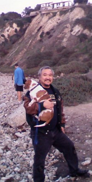 Bogey going for a walk on the beach near Torrance, California with sports reporter Vern Hee. Who is really doing the walking here?  Special to the Pahrump Valley Times