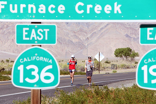 Trasie Phan Special to the Pahrump Valley Times Above, Pete Kostelnick runs with crew member  Kyle Clouston. Kostelnick is the 2016 winner of the Styr Labs Badwater 135 joins an elite number of ru ...