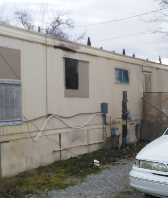 Though just a few singe marks can be seen from the exterior of this mobile home, the majority of the damage was contained in the interior of the structure after a fire broke out late Tuesday eveni ...