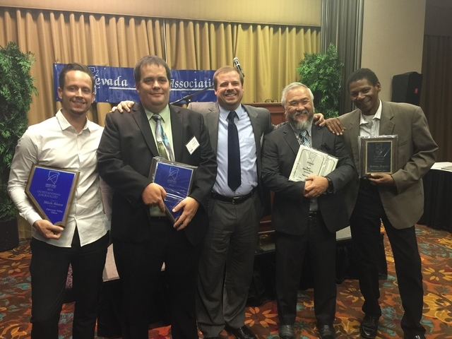 Pahrump Valley Times reporter Mick Akers (from left), editor Arnold Knightly, publisher Noah Cusick, sports writer Vern Hee and reporter Selwyn Harris display some of the 10 awards the paper took  ...