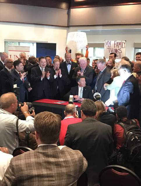 Gov. Brian Sandoval signs Senate Bill 1 during a ceremony at the University of Nevada, Las Vegas Monday. Nye County's state representatives all voted against the bill.  Mick Akers/Pahrump Valley Times