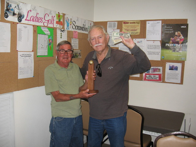 Tournament director Ed Plavac, left, presenting the men's club trophy to Roy Barnes at the Lakeview Executive Golf Course.  Special to the Pahrump Valley Times