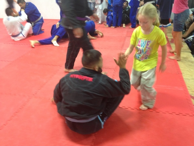 Special to the Pahrump Valley Times  A young girl gets her first jiu-jitsu instruction at Cascao Jiu Jitsu at the VIP Cheer Gym on State Street at the grand opening on Saturday.