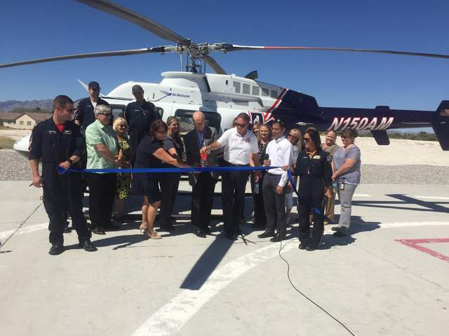 Desert View Hospital CEO Kelly Adams cuts the ribbon to christen in the Mercy Air's Airbase 24 located at the hospital.  Mick Akers/Pahrump Valley Times