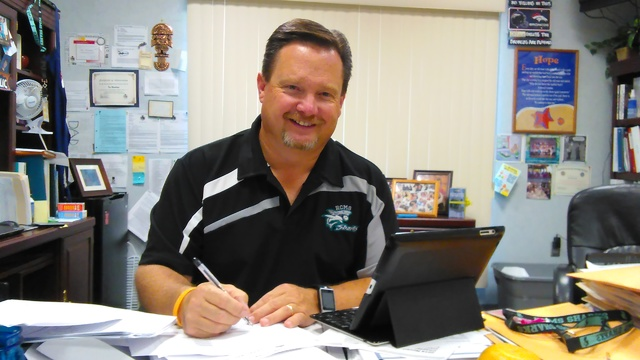 Rosemary Clarke Principal Tim Wombaker pores over his notes from a three-day conference held in Westlake, California. Wombaker noted RCMS was the first school to implement an online system known a ...