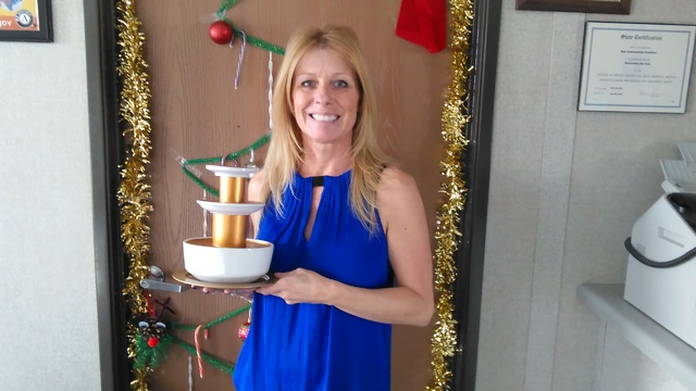 Selwyn Harris/Pahrump Valley Times Dianna Carrell, Fiscal Administrative Assistant for NyE Communities Coalition holds aloft the coveted Chocolate Buffet trophy. The organization invited community ...