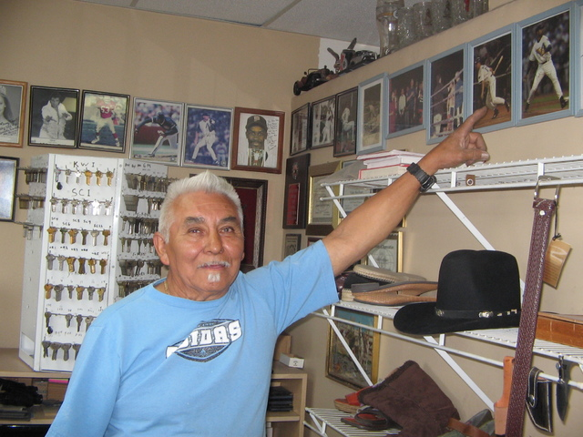 Brenda Klinger / Special to the Pahrump Valley Times   Jose Valdez points to one of his many photos/autographs of sports figures he met while operating a shoe repair   shop for 33 years in Scottsd ...