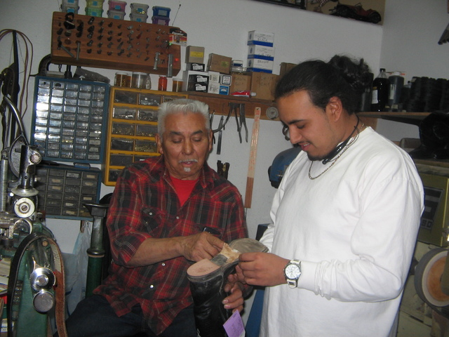 Brenda Klinger / Special to the Pahrump Valley Times   Jose Valdez is teaching his grandson Steve Venegas, 22, of  Pahrump how to repair shoes with the hopes of him taking over the shop  someday.