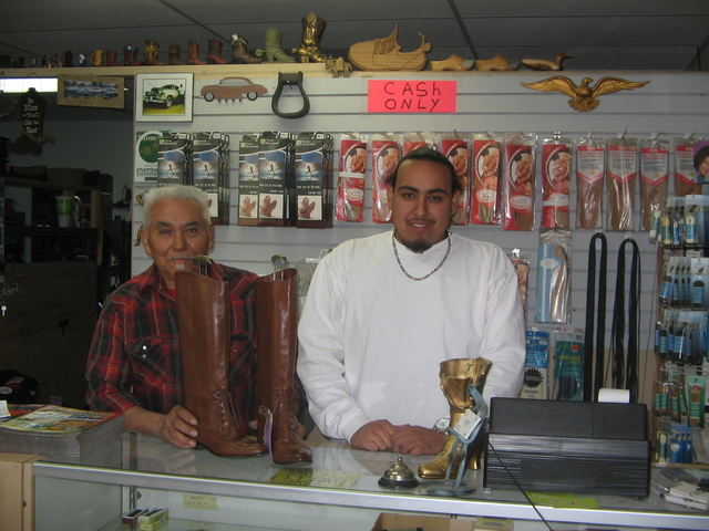 Brenda Klinger / Special to the Pahrump Valley Times   Pahrump's only shoe repairman, Jose Valdez (left) along with  grandson Steve Venegas, 22, at the front counter of Valdez Shoe Repair 361  S ...