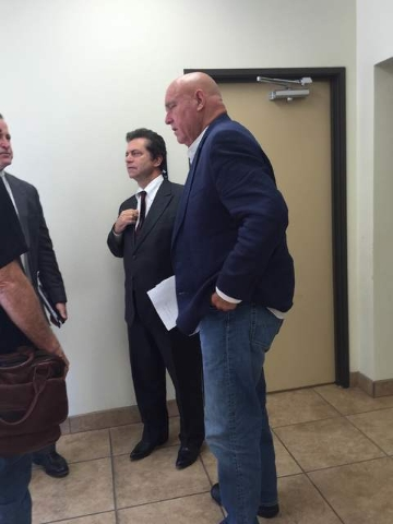 Dennis Hof (pictured left) speaks with members of his legal council including Mark Riseman (middle) after the Nye County board of commissioners decided to postpone item on possible brothel code ch ...