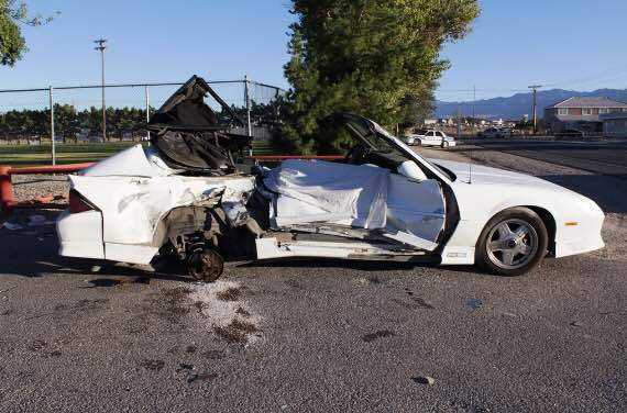 The white Chevrolet Camaro that the two victims were traveling was heavily damaged on the passenger side, where Ashley Weir was sitting when the crash occurred.  Special to the Pahrump Valley Times.