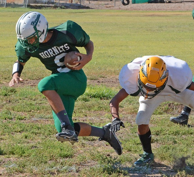 Richard Stephens / Pahrump Valley Times Sophomore quarterback Jacob Henry runs the ball against Big Pine as a freshman in last year's game.