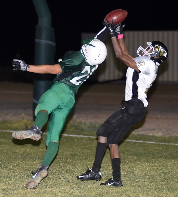 Richard Stephens / Pahrump Valley Times  Jacob Oseguera gets a hand on the ball and saves a TD.