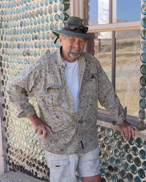 Special to the Pahrump Valley Times Karl Olson, the organizer of the Beatty VFW Turkey Shoot, stands next to the bottle house in Rhyolite. All benefits from the shoot go to the Beatty VFW communit ...