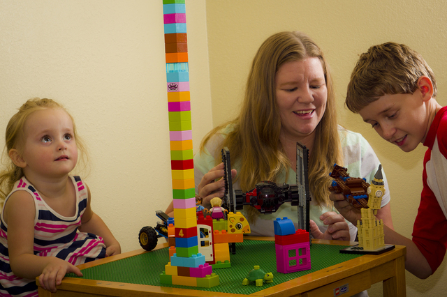 Ashley Hall, (center), shares some quality time with her kids Zoe, 3, (left) and Zeke, 12. Hall is hosting the inaugural Pahrump Lego Club meeting on Saturday at the Pahrump Community Library begi ...