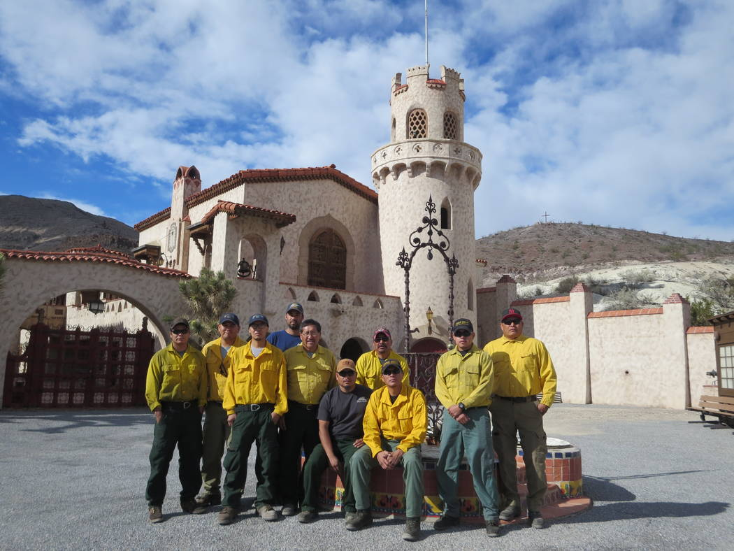 A National Park Service crew from Mesa Verde National Park helped remove mud from inside and around the historic buildings at Scotty's Castle.  Special to the Pahrump Valley Times