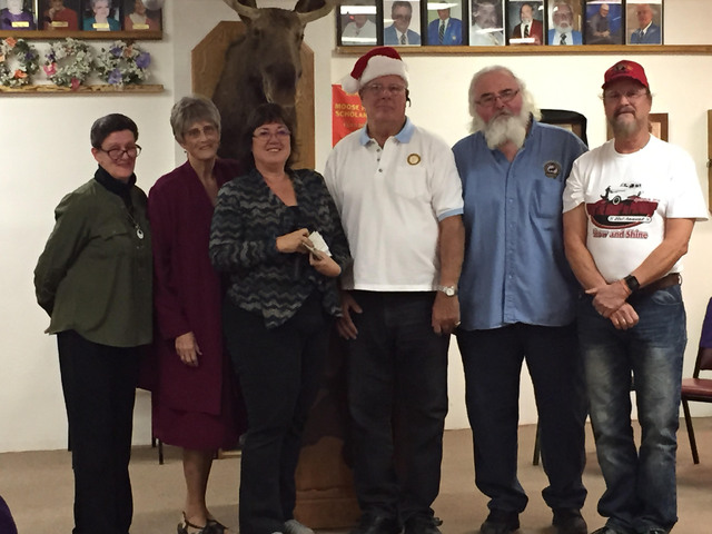Nye County School District Homeless Liasion Linda Fitzgibbons, third from left accepts two checks totaling $3,900 from members of the Pahrump Moose Lodge and the Valley Cruisers of Pahrump. Fitzgi ...