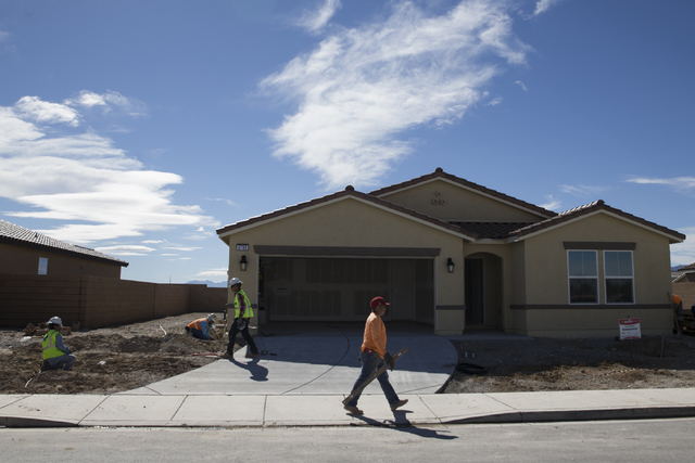 Workers finish homes Feb. 16 at the Burson Ranch community by Beazer Homes in Pahrump. Nye County Planning Director Darrell Lacy said Beazer pulled about 10 permits in the past few months.  Erik V ...