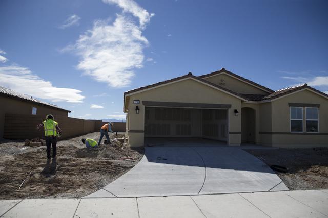 Workers finish homes at the Burson Ranch community by Beazer Homes, Thursday, Feb. 16, 2017, in Pahrump, Nev. (Erik Verduzco/Las Vegas Review-Journal) @Erik_Verduzco