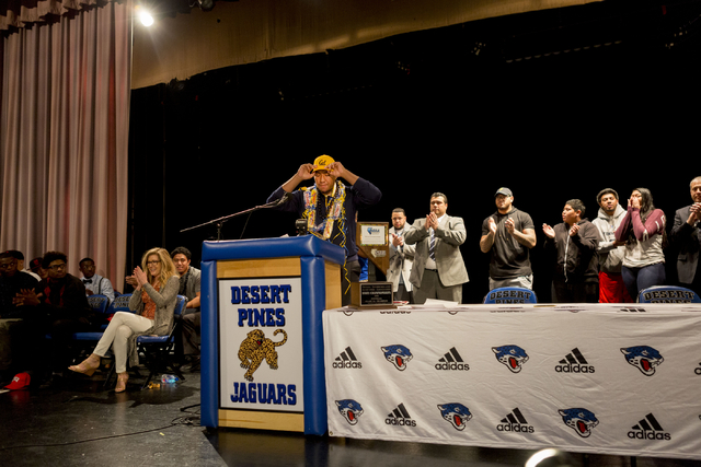 Desert Pines senior Poutasi Poutasi announces his decision to play college football for University of California on Wednesday, hours before his mom died.  Elizabeth Brumley/Special to the Pahrump  ...