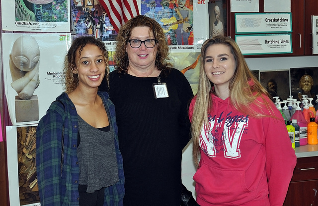 Horace Langford Jr. / Pahrump Valley Times  From left, senior Syamini Breathwaite, art teacher Crystal Dabrowski and sophomore Lainey Dattillo. The two students had their work displayed on Jan. 21 ...