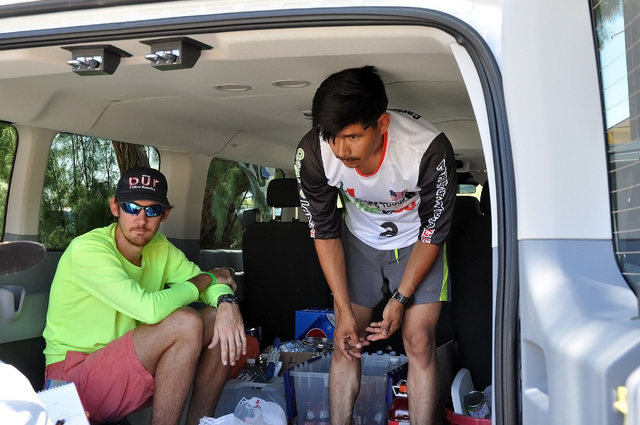 Horace Langford Jr / Pahrump Valley Times  Two-time Badwater champion Oswaldo Lopez's crew members, Winston Fletcher, left, and Carlos Vasquez, right, talk about their racer's toughness.