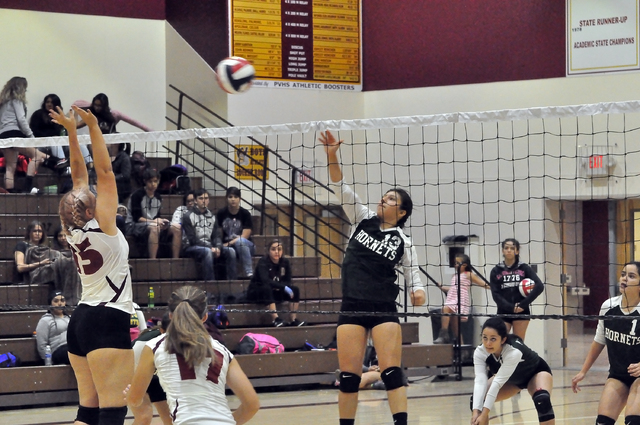 Karina Villanueva gets air against Pahrump. The Hornets tuned up for their game against Tonopah today by playing the Pahrump junior varsity squad, where the Hornets won in three sets.  Horace Lang ...