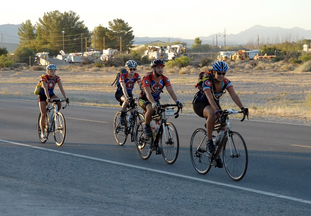 Horace Langford Jr / Pahrump Valley Times  Riders from Bike and Build ride down Wilson Road on Wednesday morning on their way to Furnace Creek. Bike and Build uses rides throughout the country to  ...