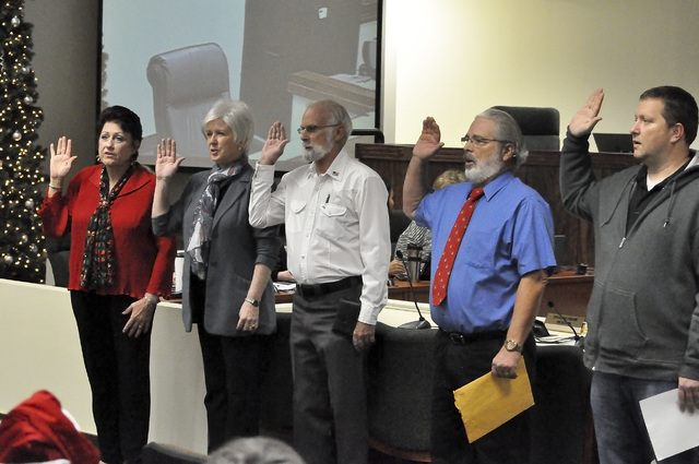From left to right: Nye County Commissioners Donna Cox, Lorinda Wichman, Frank Carbone and Nye County School Board Trustees Lawrence Small and Mark Hansen swear in at the ceremony for newly electe ...