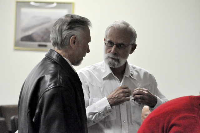 Outgoing Nye County Commissioner Frank Carbone, left, talks to incoming commissioner John Koenig who will take his seat on Jan. 3. Carbone decided not to run for a second term. Horace Langford Jr. ...