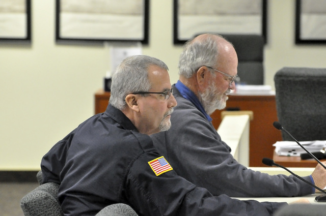 Vance Payne, director of Nye County Emergency Services director, left, and Mike Cottingham, town manager of Amargosa Valley, discuss emergency service issues at the Dec. 20 meeting of the Nye Coun ...