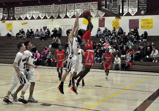 Horace Langford Jr. / Pahrump Valley Times Senior Nick Harris tries to stop a Western player from scoring in the first half. The Trojans put themselves in a 28-15 hole in the half, but then turned ...
