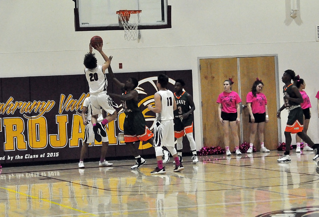 David Sidhu is seen scoring against Mojave on Monday. Sidhu fouled out of the game in the fourth quarter, which didn't help the Trojans offensively.  Horace Langford Jr. / Pahrump Valley Times