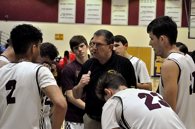 Horace Langford Jr. / Pahrump Valley Times Trojans coach John Toomer gets his team fired up during the Western game.
